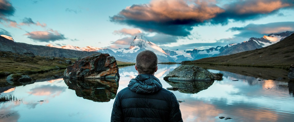 Unsplash photo-Guy looking over lake cropped 1