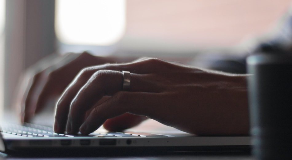 Unsplash photo-person typing on computer cropped