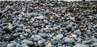 Unsplash photo - Pebbles beach cropped